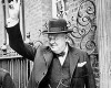 Churchill waves the victory sign outside No. 10 Downing Street during the war years.